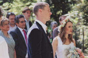 A bride and groom in an outdoor wedding ceremony