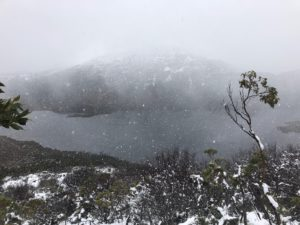 Mist over a lake with snow on the mountains